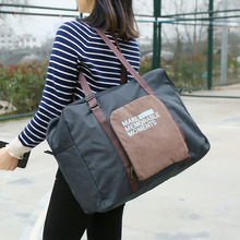 A lady's handbag with foldable clothes. A large-capacity pull-rod suitcase, luggage bag.